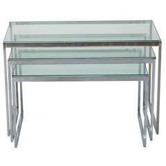 Three Mid Century Polished Nickel and Glass Nesting Tables