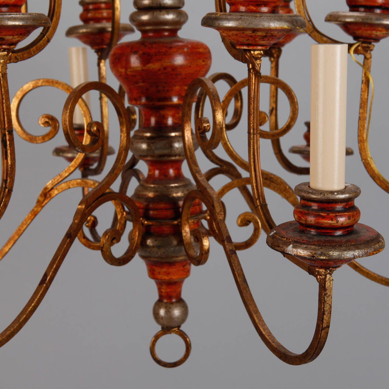 Turned Twelve Light Italian Painted Wood and Scrolled Gilt Metal Chandelier For Sale
