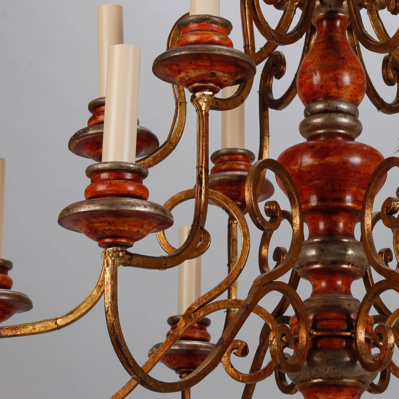 Iron Twelve Light Italian Painted Wood and Scrolled Gilt Metal Chandelier For Sale