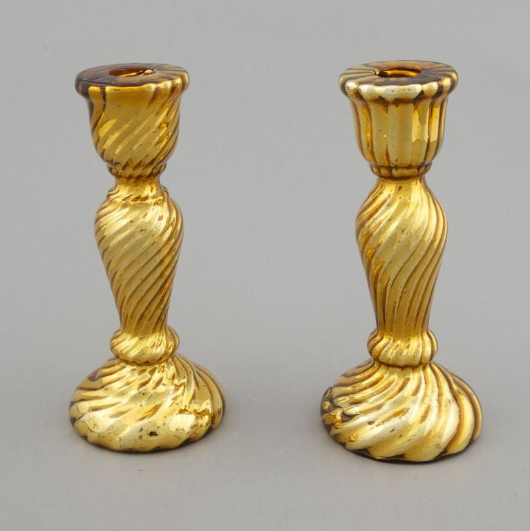Gold tone swirled texture mercury glass candlestick. Two this shape and size are available. Sold and priced separately.