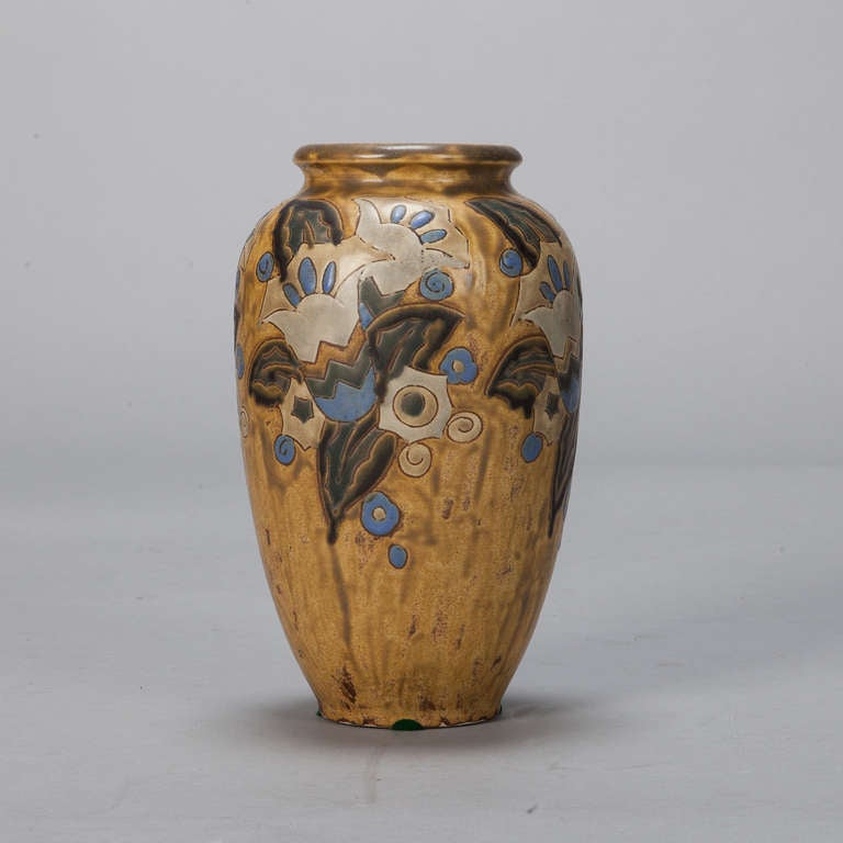 Art Deco era Boch ceramic vase with mustard or gold colored glazed with blue stylized floral design attributed to Charles Catteau. Marked on the bottom Gres Keramis – Boch, Belgium 911.