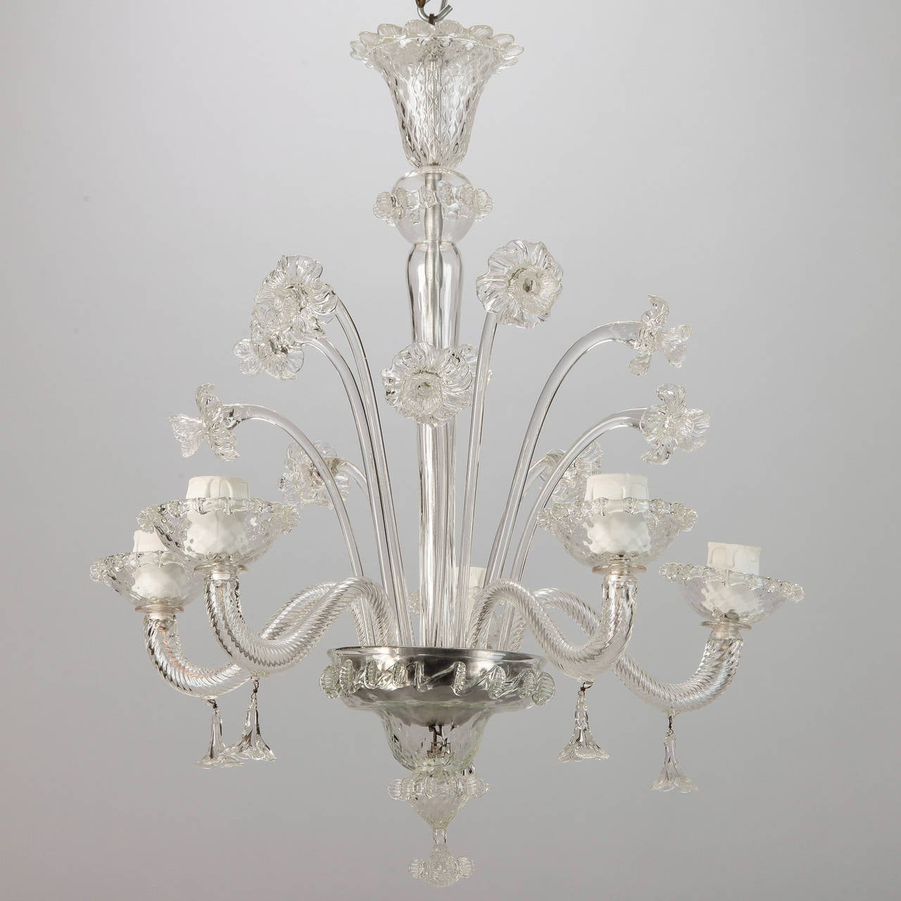 Venetian glass chandelier with several handcrafted large daffodils and five candle style lights, circa 1900. New electrical wiring for US standards. # of sockets: Five Socket type: Regular.