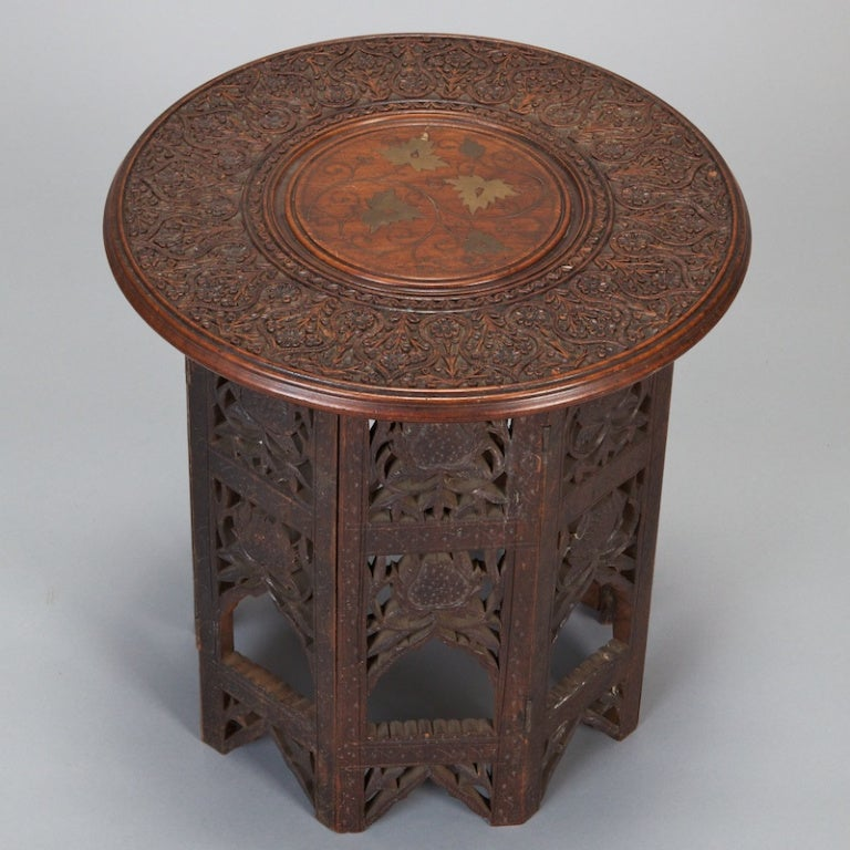 Small carved wood moorish table with brass inlay at 1stdibs for Oriental wood carved furniture