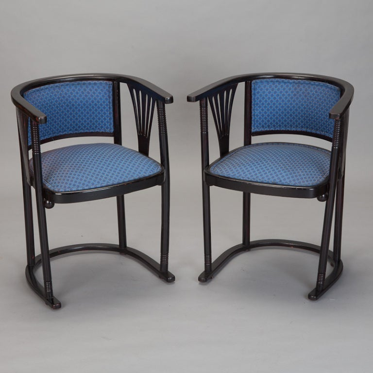 "Pair of Josef Hoffmann armchairs with dark brown, nearly black stained wood frames with U-shaped curved base and backs, blue upholstery and slatted fan details at the sides, circa 1910. Measures: Seats are 18"" high. Sold and priced as a pair."