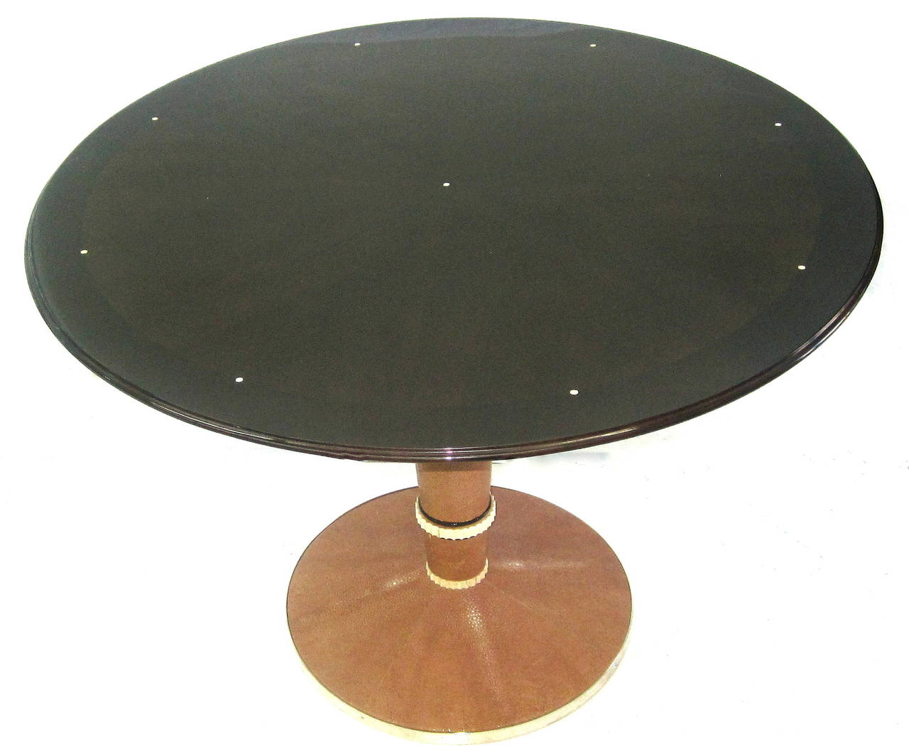 A Unique French Art Deco Table by Saddier in Exotic Wood, Mother of Pearl Inlay, Shagreen Base Adorned with Bakelite, and Nickeled Metal Trim to Complete the Refined Elegance of this One-of-a-Kind Piece.
