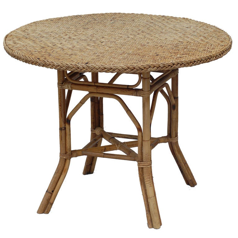 round dining table in rattan and bamboo at 1stdibs