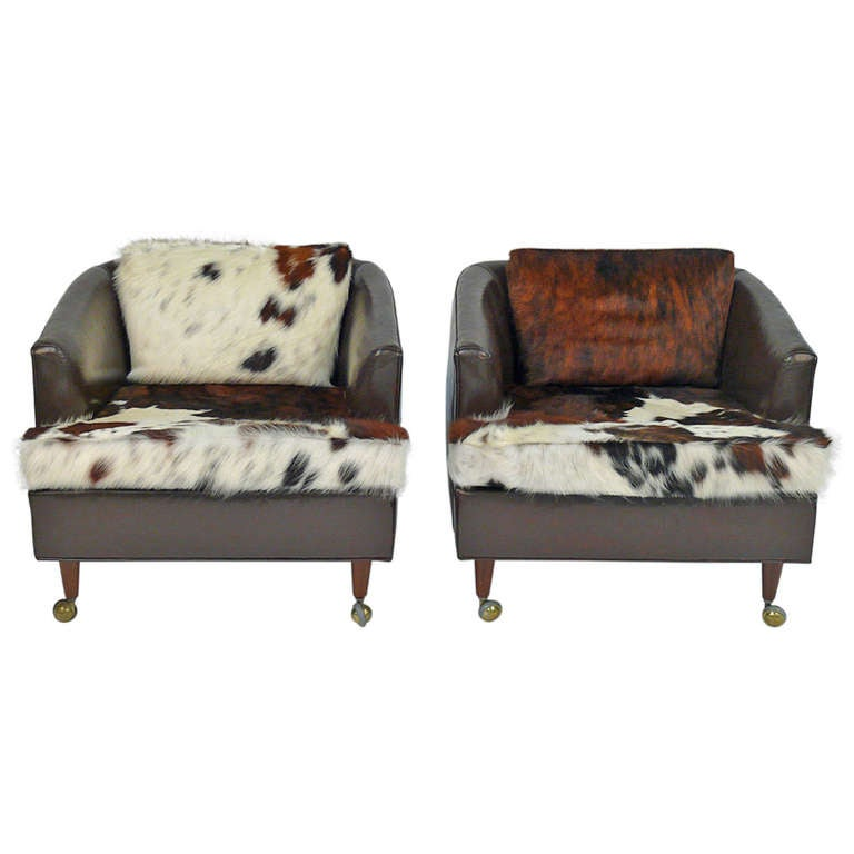 Awesome Pair Of Leather Club Chairs Castored With New Cowhide Upholstery For Sale