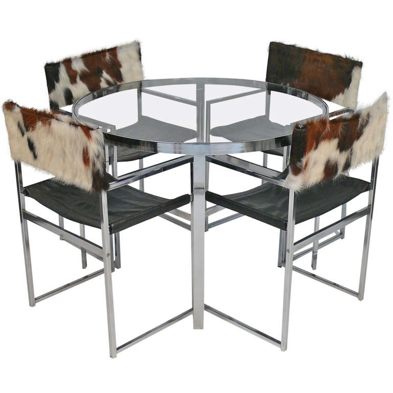 Chrome and Glass Table with Cowhide and Chrome Chairs at