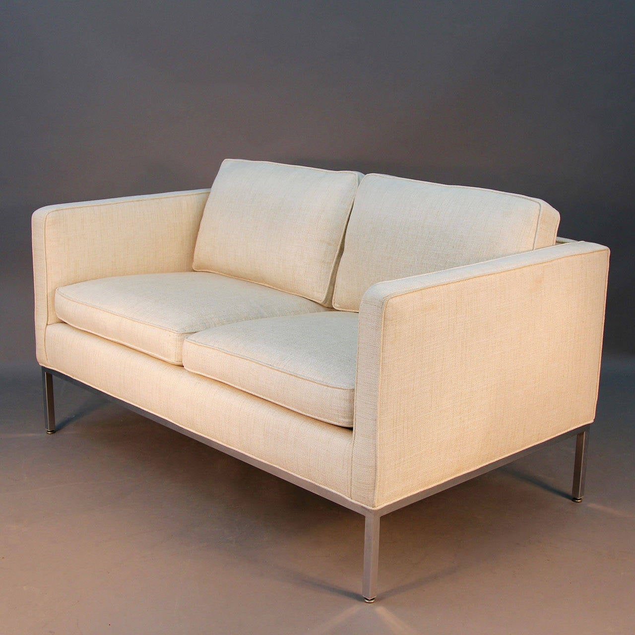 Beautiful off-white linen loveseat sofa with chrome legs and frame design by Milo Baughman for Thayer Coggin with original label. Incredible lines and simple form. Very comfortable piece.