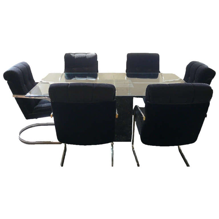 artedi dining table with six velvet and chrome chairs at