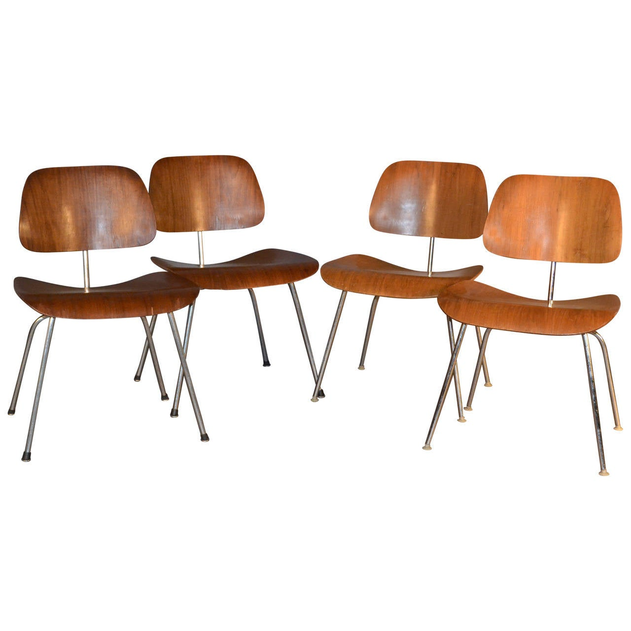 eames mixed set of four dcm dining chairs for herman miller at 1stdibs