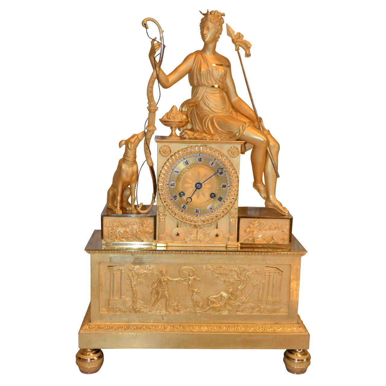 French Empire Gilt Mantel Clock Featuring A Seated Diana