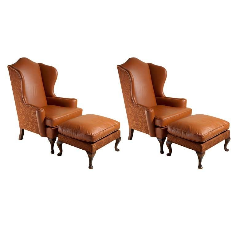 Pair of carmel leather wing chairs and ottomans at 1stdibs