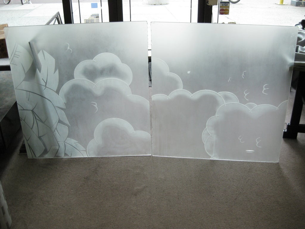Two acid etched frosted glass architectural panels from the Art Deco period. The cloud and bird motif drift across the scene while the highly stylized foliate motif on the border serves as an anchor to this pictorial canvas. You can frame these out
