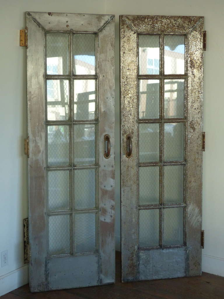 Heavy Steel French Doors With Hinges And Pulls. Wire Mesh Glass In Original  Untouched Patina