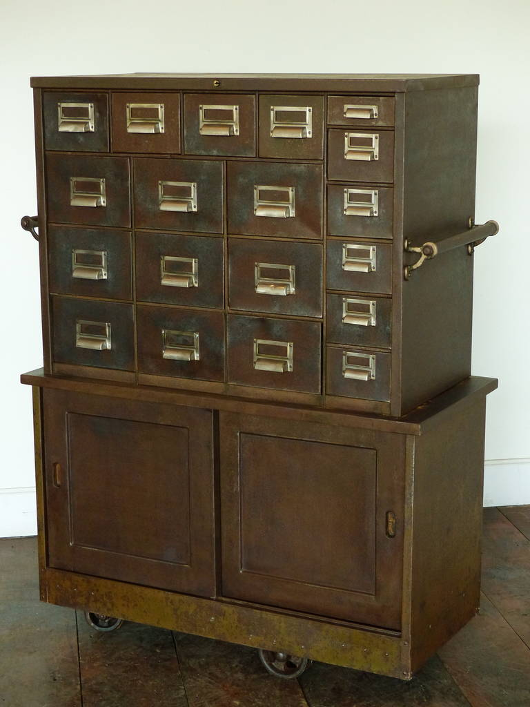 Metal apothecary with two doors 1930 at 1stdibs for 1930s front door furniture