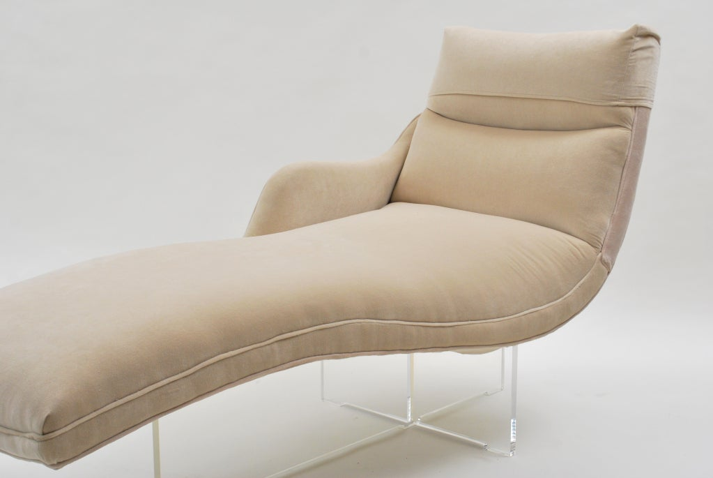 "Beautiful streamlined modernist chaise longue by Vladimir Kagan. The clear lucite base gives this elegant design a small footprint, and a ""floating"" appearance. Re-upholstered in a lovely and soft, light beige Scalamandre velvet.<br /> <br"