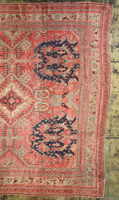 Large square Oushak rug with lovely red, navy, cream and light celedon green. This Oushak rug has a short, soft pile and is an unusual square size.
