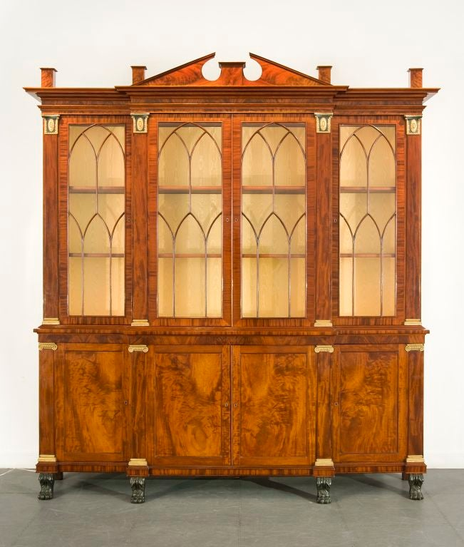 Breakfront bookcase [library book case with wings], circa 1815–1820 New York Mahogany (secondary woods: mahogany, pine, and poplar), with wood and composition capitals and bases, variously painted verde antique and gilded, glass, and brass