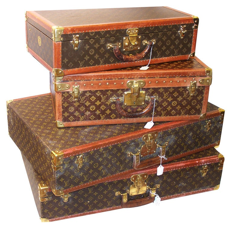 Four pieces of Vintage Louis Vuitton hardside luggage at ...