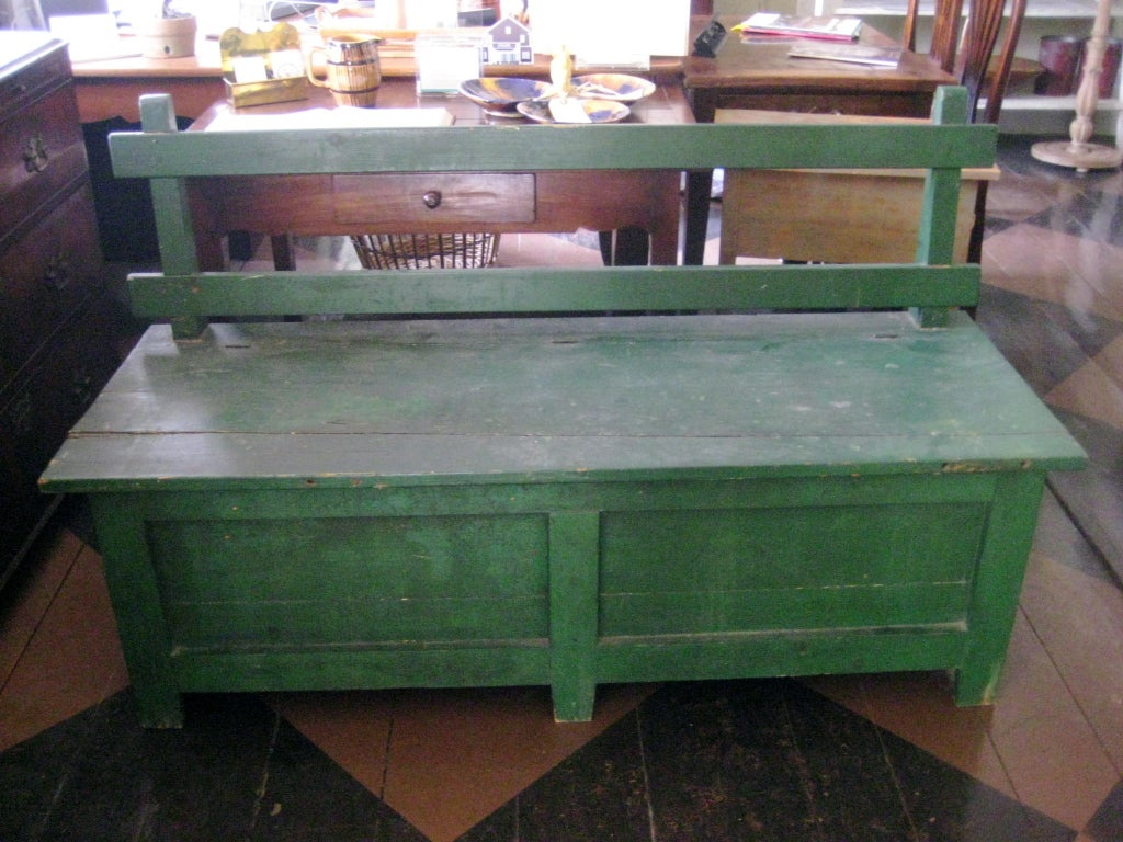 English green painted bench with rustic back and lift seat