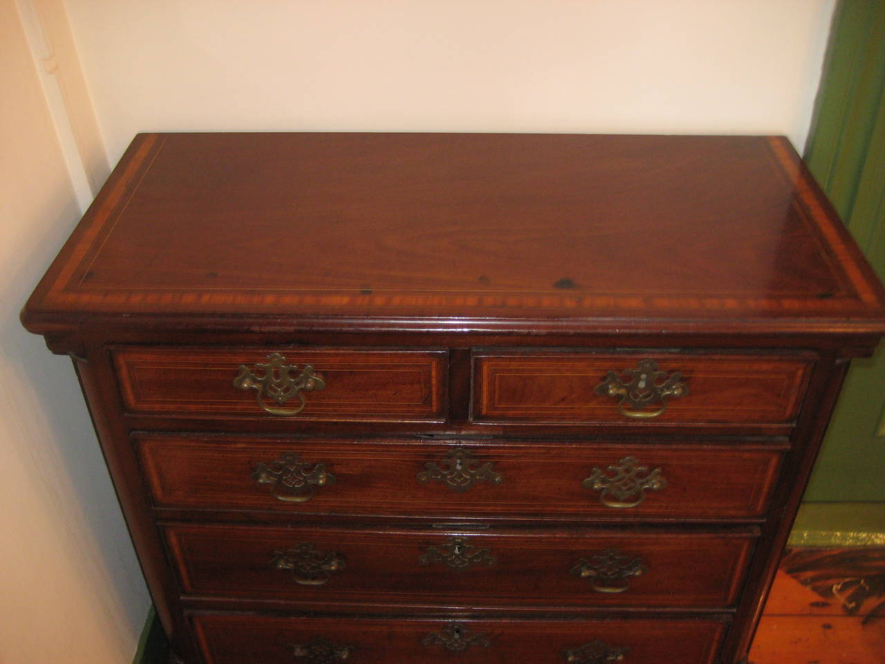 English 19th Century inlaid small chest of drawers.