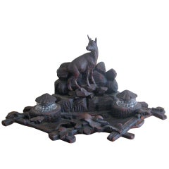 Carved black forest inkwell
