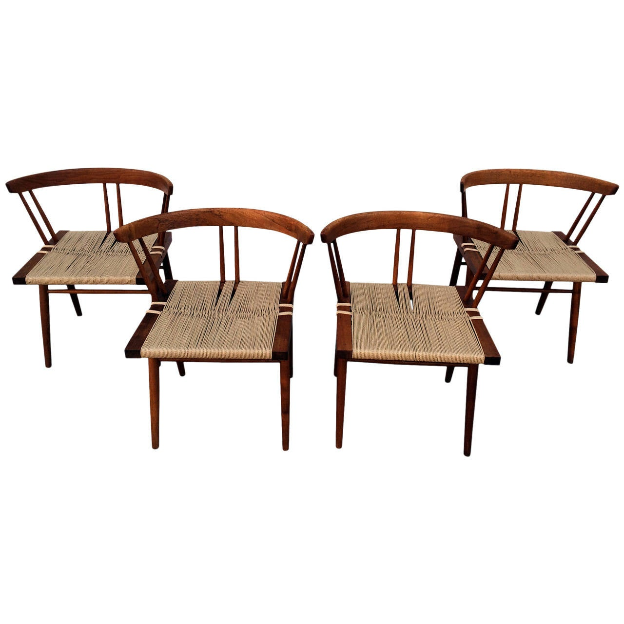 Set of four walnut and woven seat chairs by george nakashima for sale
