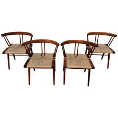 Set of Four Walnut and Woven Seat Chairs by George Nakashima