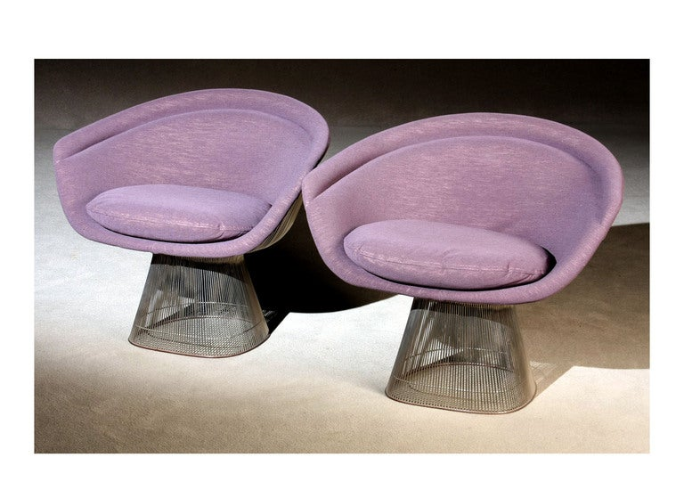 A pair of iconic wire lounge chairs designed by Warren Platner in 1966 for Knoll. Nickle-plated steel rod construction with a fully upholstered back and arm. These chairs were produced in 1984 as indicated by the tag.