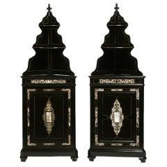 Pair Italian renaissance revival ebonized corner cabinets