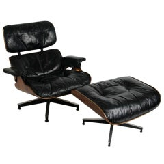 Early Charles Eames Rosewood lounge chair and ottoman