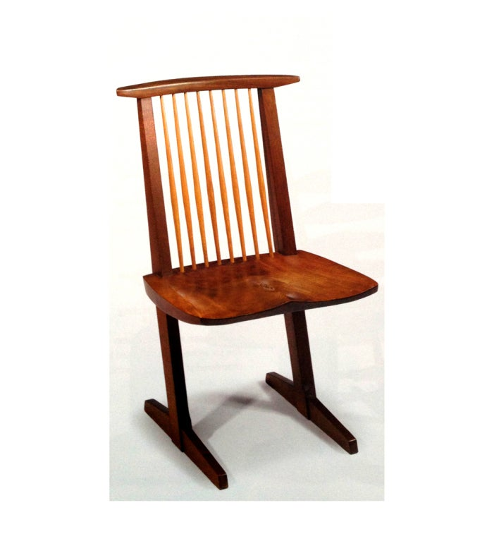 A single walnut conoid side chair designed and made by famed cabinet maker george nakashima in 1980. The seat has beautiful grains and it is inscribed,