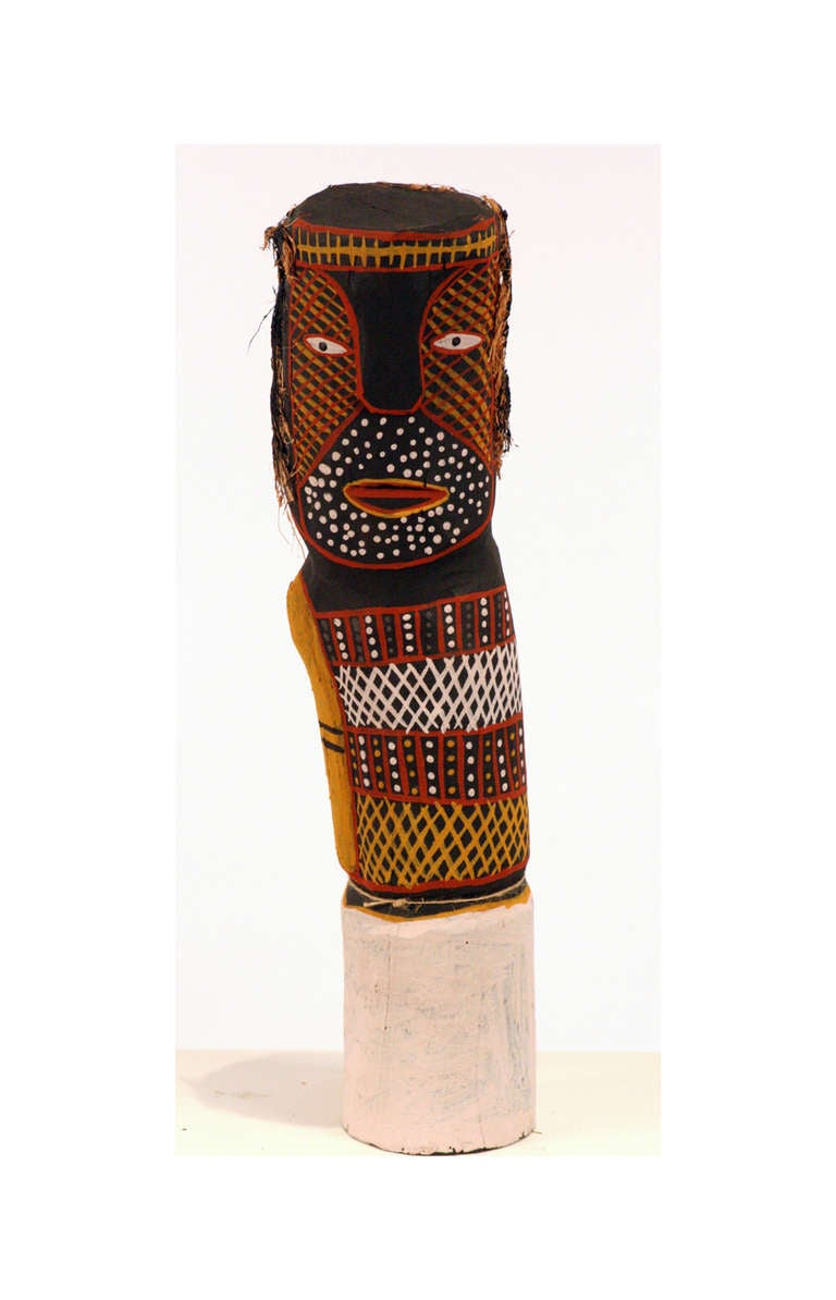Collected in Tiwi Island off the coast of Northern Australia, this Bima Figure Carving was carved and painted by Myra Ann Tipiloura out of Iron wood. It was painted in the clan pattern with ocher and decorated with coconut fiber. It represents Bima