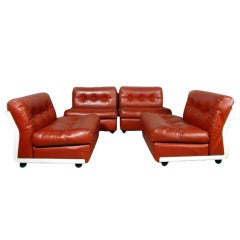 Set of four vintage Amanta modular slipper chairs Mario Bellini