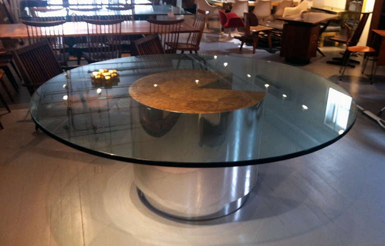large burl and chrome round dining table with glass top