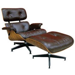 Rosewood brown leather lounge chair and ottoman Charles Eamess B