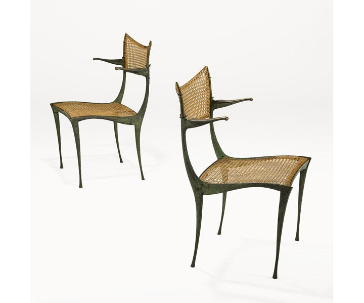 A pair of bronze gazelle arm chair model 20B. These amazingly sculptural chairs were designed and cast in solid bronze by Dan Johnson circa 1950s. Iconic mid-century silhouette that combines function with a rare sculptural quality. Cane seats and