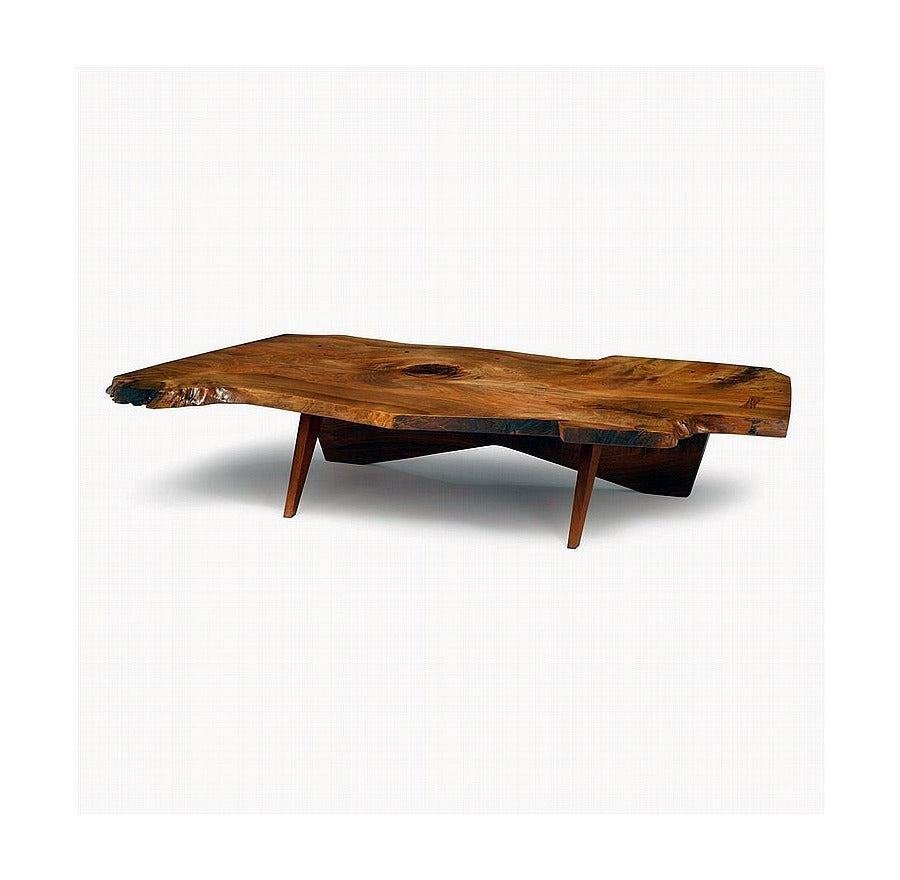 An extraordinary piece of early work crafted by George Nakashima in his studio, circa 1967. This coffee table is unusual in its massive size and stunning presence. The top slab is of American black walnut and features free edges all around with