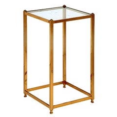 A Brass side table by John Vesey