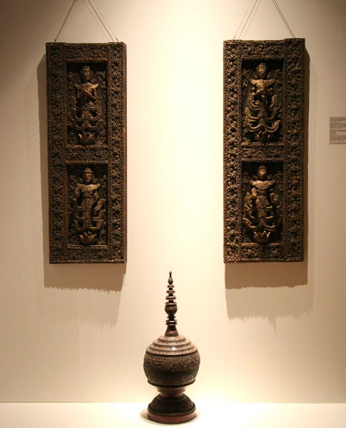 Carved with extremely elaborate details, this pair of architectural window panels were decorated with relief of stylized Kinnari, the half woman, half swan creatures that excel in singing and dancing. Such exuberant designs were mostly used in