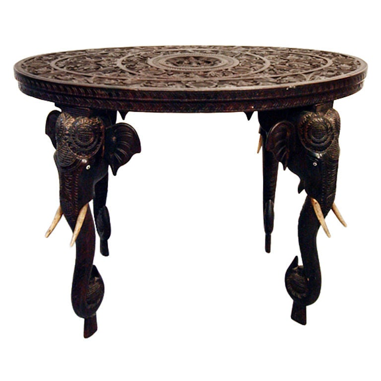 On hold indian rosewood table with elephant legs and ivory tusks at 1stdibs Elephant coffee table