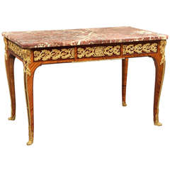 Gilt Bronze-Mounted Kingwood and Mahogany Center Table