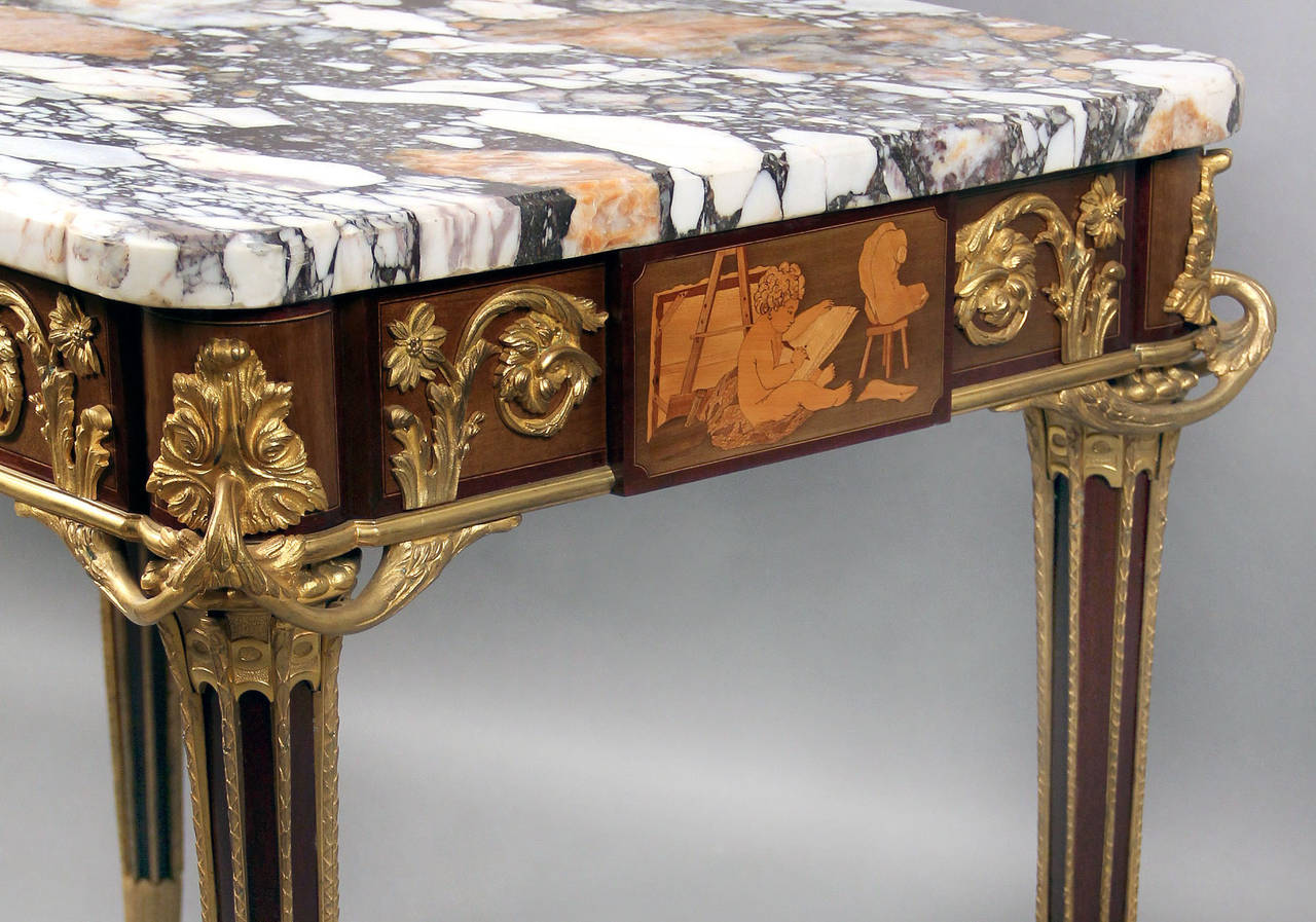 An exceptional late 19th century Louis XVI style gilt bronze-mounted inlaid marquetry center table.