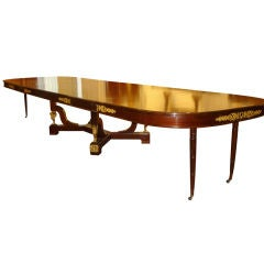 An Important late 19th century gilt bronze-mounted Empire style dining table