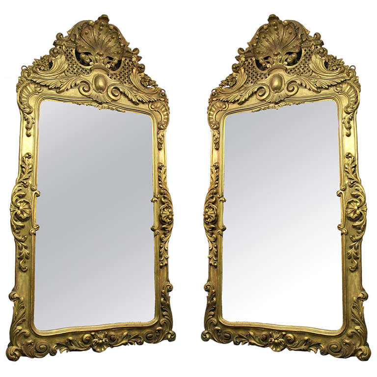 Pair of Large Hand-Carved Giltwood Mirrors