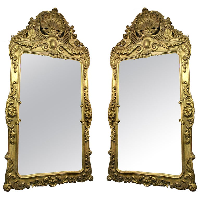 A Pair of Large and Great Quality Late 19th Century Hand-Carved Giltwood Mirrors For Sale