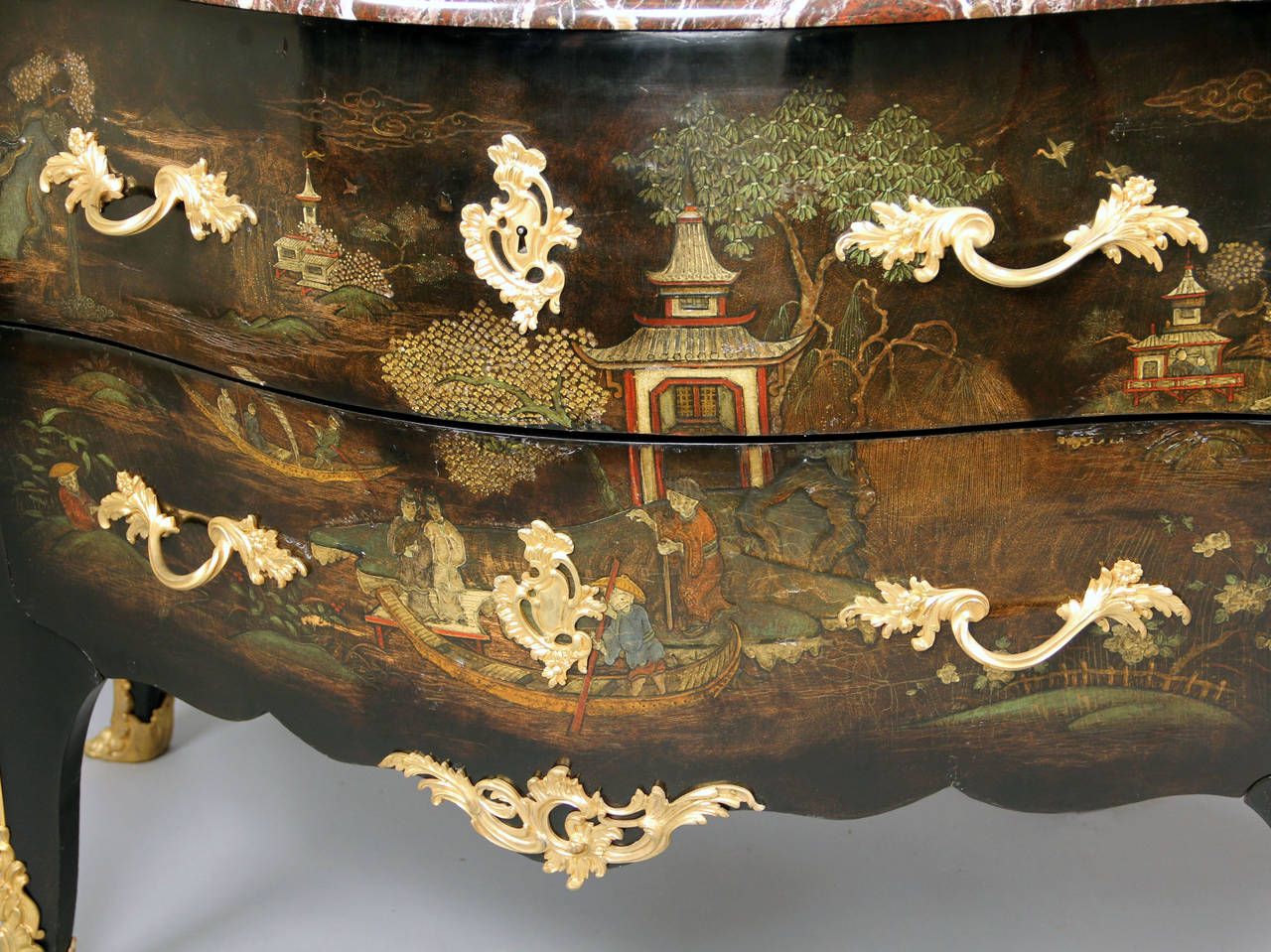 An Exceptional Late 19th Century Louis XV Style Gilt Bronze Mounted Lacquer Commode  By Henry Dasson  With a shaped marble top above two drawers veneered san traverse.  Signed Henry Dasson 1870 to the right front bronze.  Henry Dasson was considered