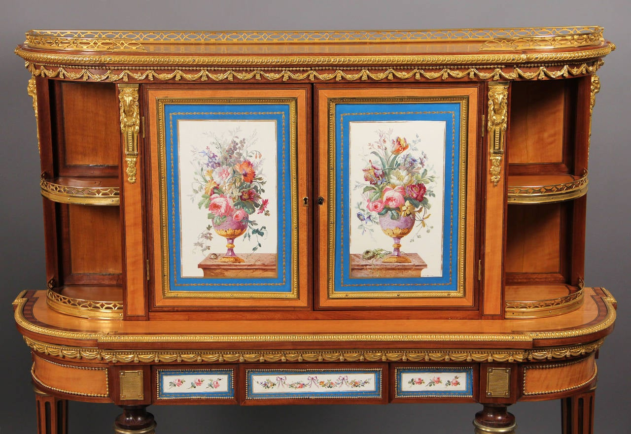 A very fine pair of late 19th century gilt bronze and Sèvres Style porcelain mounted kingwood cabinets. 