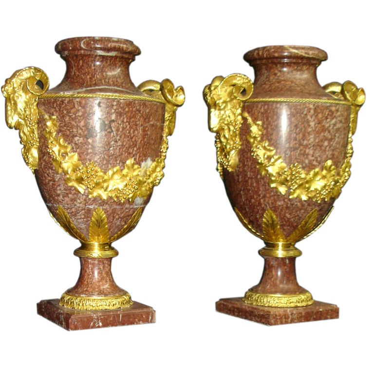 A large and impressive pair of late 19th century gilt bronze mounted Urns